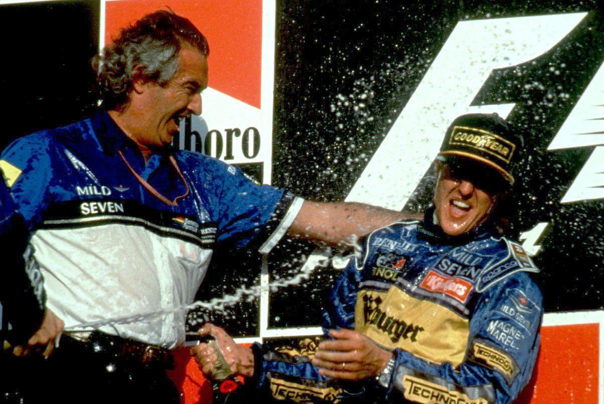 Flavio Briatore és Michael Schumacher 1995-ben a dobogó tetején (Fotó: xpbiamges.com)