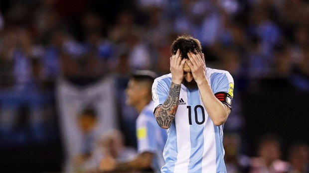 epa05875531 (FILE) Argentina's Lionel Messi reacts during the FIFA World Cup 2018 qualifying soccer match between Argentina and Chile in Buenos Aires, Argentina, 23 March 2017, (reissued 28 March 2017). Argentinian striker Lionel Messi has been banned for four international soccer matches for 'insulting' an assistant referee during the qualifier against Chile, the FIFA confirmed on 28 March 2017.  EPA/DAVID FERNANDEZ