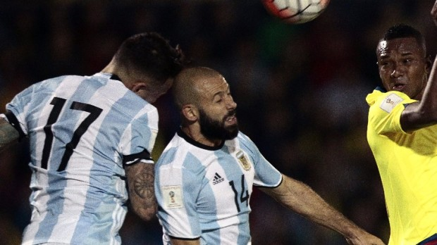 epa06258037 Argentina's Javier Mascherano (C) and Nicolas Otamendi (L) vie for the ball with Pedro Velasco (R) of Ecuador during the FIFA World Cup 2018 qualifying soccer match between Ecuador and Argentina at the Atahualpa Stadium in Quito, Ecuador, 10 October 2017.  EPA/JOSE JACOME