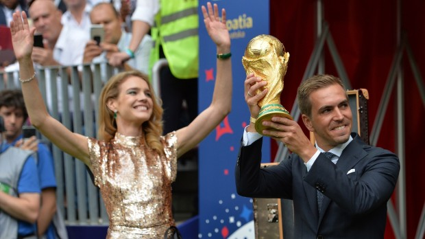 epa06890545 Former German international Philipp Lahm (R) and Russian model Natalia Vodianova present the World Cup trophy before the FIFA World Cup 2018 final between France and Croatia in Moscow, Russia, 15 July 2018. (RESTRICTIONS APPLY: Editorial Use Only, not used in association with any commercial entity - Images must not be used in any form of alert service or push service of any kind including via mobile alert services, downloads to mobile devices or MMS messaging - Images must appear as still images and must not emulate match action video footage - No alteration is made to, and no text or image is superimposed over, any published image which: (a) intentionally obscures or removes a sponsor identification image; or (b) adds or overlays the commercial identification of any third party which is not officially associated with the FIFA World Cup)  EPA/PETER POWELL   EDITORIAL USE ONLY