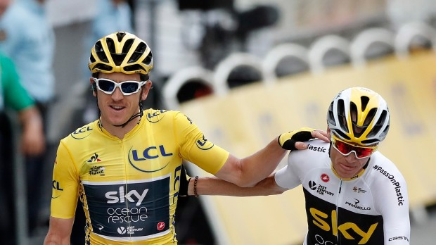 epa07225319 (FILE) - Team Sky rider Geraint Thomas (C) of Britain, wearing the overall leader yellow jersey, celebrates his win with Chris Froome of Britain following the 21st and final stage of the 105th edition of the Tour de France cycling race over 116km between Houilles and Paris, France, 29 July 2018, (reissued 12 December 2018). Media reports on 12 December 2018 state that broadcaster Sky has announced that it will end it's backing of Team Sky in 2019.  EPA/CHRISTOPHE PETIT TESSON *** Local Caption *** 54520688