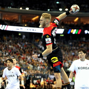 epa07273820 Matthias Musche (C) of Germany in action during the match between Germany and Korea at the IHF Men's Handball World Championship in Berlin, Germany, 10 January 2019.  EPA/HAYOUNG JEON