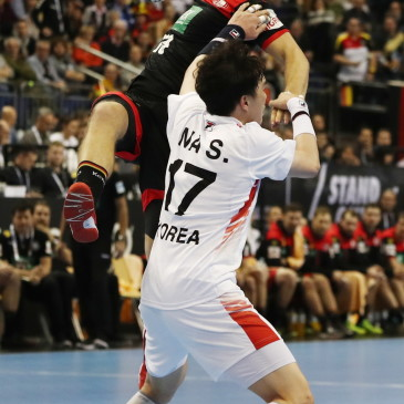 epa07273847 Martin Strobel (L) of Germany in action Na Seungdo (R) of Korea  during the match between Germany and Korea at the IHF Men's Handball World Championship in Berlin, Germany, 10 January 2019.  EPA/HAYOUNG JEON