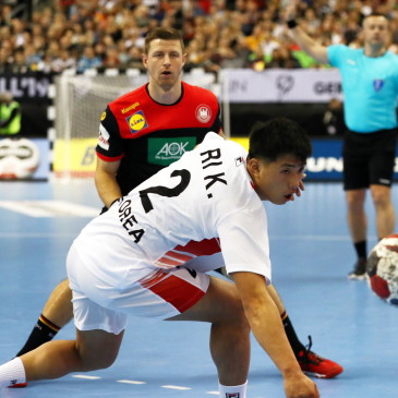 epa07273854 Ri Kyong Song (C) of North Korea in action during the match between Germany and Korea at the IHF Men's Handball World Championship in Berlin, Germany, 10 January 2019.  EPA/HAYOUNG JEON