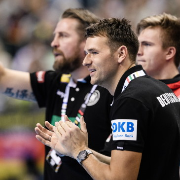 epa07273927 Head coach Christian Prokop of Germany (C) applauds next to team manager Oliver Roggisch (L) during the match between Germany and Korea at the IHF Men's Handball World Championship in Berlin, Germany, 10 January 2019.  EPA/CLEMENS BILAN