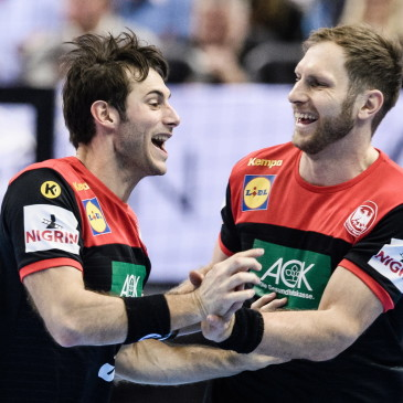 epa07273929 Uwe Gensheimer of Germany (L) and Steffen Weinhold of Germany celebrate after a scoring during the match between Germany and Korea at the IHF Men's Handball World Championship in Berlin, Germany, 10 January 2019.  EPA/CLEMENS BILAN