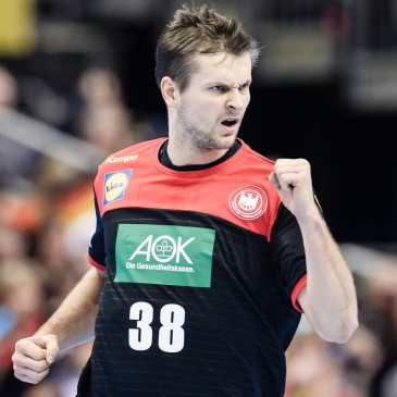 epa07273930 Fabian Boehm of Germany gestures after scoring during the match between Germany and Korea at the IHF Men's Handball World Championship in Berlin, Germany, 10 January 2019.  EPA/CLEMENS BILAN