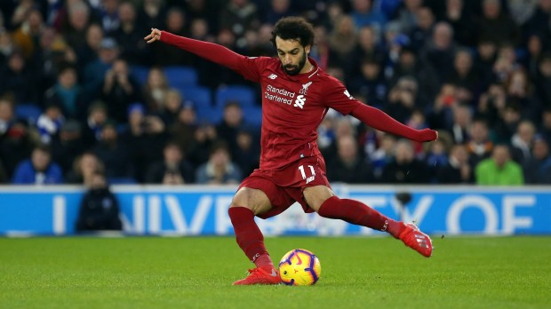 epa07278074 Liverpool's Mohamed Salah scores the opening goal during the English Premier League soccer match between Brighton Hove Albion and Liverpool at the Amex Stadium in Brighton, Britain, 12 January 2019.  EPA/James Boardman EDITORIAL USE ONLY. No use with unauthorized audio, video, data, fixture lists, club/league logos or 'live' services. Online in-match use limited to 120 images, no video emulation. No use in betting, games or single club/league/player publications