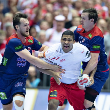 epa07325684 Mads Mensah of Denmark against right Sander Sagosen of Norway during the men's IHF Handball World Championship gold medal match between Denmark and Norway in Herning, Denmark, 26 January 2019.  EPA/HENNING BAGGER DENMARK OUT