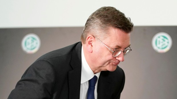 epa07480215 German Football Association (DFB) president Reinhard Grindel leaves a press conference at the DFB headquarters in Frankfurt Main, Germany, 02 April 2019. Grindel has announced the resignation from his office.  EPA/RONALD WITTEK