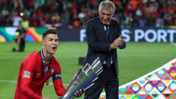 epa07637851 Portugal player Cristiano Ronaldo celebrates with the trophy next to Portuguese head coach Fernando Santos after winning the UEFA Nations League final soccer match Portugal vs Netherlands at Dragao stadium, Porto, Portugal, 09 June 2019.  EPA/PAULO NOVAIS