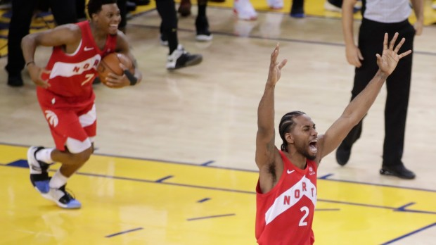 epa07647068 Toronto Raptors forward Kawhi Leonard (R) reacts at the conclusion of the NBA Finals Championships game six between the Toronto Raptors at Golden State Warriors at Oracle Arena in Oakland, California, USA, 13 June 2019.  EPA/MONICA M DAVEY SHUTTERSTOCK OUT