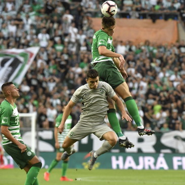 epa07708705 Dan Biton (C) of Ludogorec and Danilo Ihnatenko (R) of Ferencvaros in action during the UEFA Champions League first qualifying round first leg match Ferencvaros vs Ludogorec in Groupama Arena in Budapest, Hungary, 10 July 2019. At left Oleksandr Zubkov.  EPA/Szilard Koszticsak HUNGARY OUT