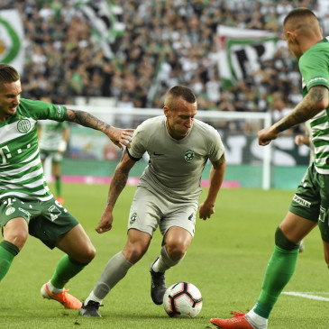epa07708706 Jacek Goralski (C) of Ludogorec, Michal Tokmac (L) and Oleksandr Zubkov of Ferencvaros in action during the UEFA Champions League first qualifying round first leg match Ferencvaros vs Ludogorec in Groupama Arena in Budapest, Hungary, 10 July 2019.  EPA/Szilard Koszticsak HUNGARY OUT