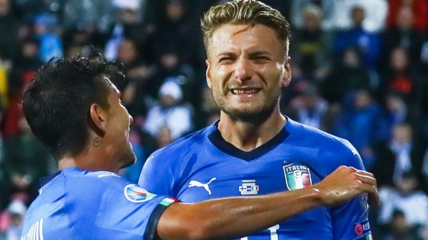 epa07828706 Ciro Immobile (R) of Italy celebrates with teammate Lorenzo Pellegrini (L) after scoring the 1-0 lead during the UEFA EURO 2020 group J qualifying soccer match between Finland and Italy in Tampere, Finland, 08 September 2019.  EPA/MAURI RATILAINEN